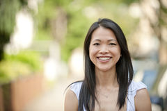 Portrait of a japanese woman outdoors. With copyspace and blur Royalty Free Stock Photo