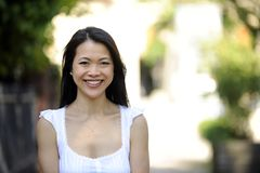 Portrait of a japanese woman outdoors. With copyspace and blur Royalty Free Stock Image