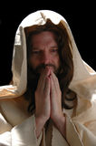 Portrait of Jesusin prayer Stock Photos