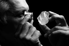 Portrait of a jeweler during the evaluation of jewels. Gemstone Stock Image
