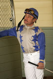 Portrait of a Jockey. ARCADIA, CA - FEB 20, 2009: Veteran thoroughbred jockey Agapito Delgadillo waits for his mount in the paddock at historic Santa Anita Park Stock Images