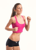 Portrait of jogging girl, on white background Royalty Free Stock Photography