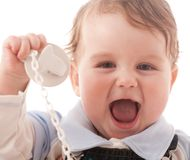 Portrait of joyful baby boy with pacifier. Over white Stock Photos
