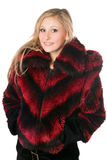 Portrait of joyful blond woman in fur jacket. Isolated Royalty Free Stock Photo