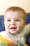 Portrait of joyful blue-eyes baby Stock Image