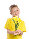Portrait of joyful boy with flowers Royalty Free Stock Images