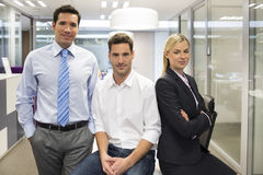 Portrait of joyful business team office background. Woman men desk smiling business Stock Images