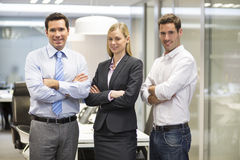 Portrait of joyful business team office background. Woman men desk smiling business Royalty Free Stock Photography