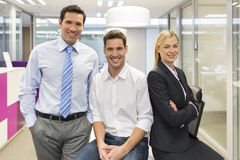 Portrait of joyful business team office background. Woman men desk smiling business Stock Image