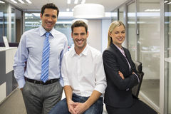Portrait of joyful business team, office background Royalty Free Stock Photos