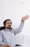 Portrait of joyful businessman throwing crumpled paper at the bu Royalty Free Stock Photos