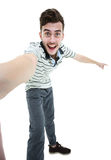 Portrait of a joyful casual man taking selfie. And holding camera with hands over white background stock photos