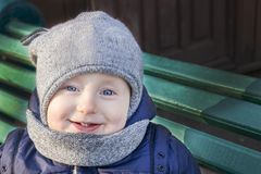 Cheerful little kid with nice smile royalty free stock photography