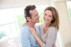 Portrait of a joyful couple in living room Royalty Free Stock Photo