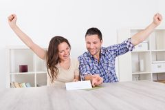 Portrait of joyful couple looking at paper Royalty Free Stock Photo
