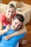 Portrait of a joyful couple in their new house. With woman showing the key to the camera stock images