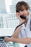 Portrait of a joyful doctor on the phone Stock Images