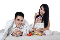 Portrait of joyful family on bed Royalty Free Stock Photography