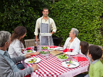 Portrait of a joyful family in the garden Stock Images