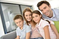 Portrait of joyful family at home Stock Image