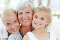 Portrait of a joyful family looking at the camera Royalty Free Stock Photo