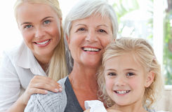Portrait of a joyful family looking at the camera Stock Photo