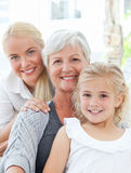 Portrait of a joyful family looking at the camera Stock Photos
