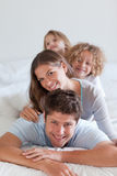 Portrait of a joyful family lying on each other Royalty Free Stock Photography