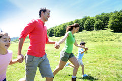 Portrait of joyful family running in the mountains. Happy family enjoying and running together in the mountains Stock Photos