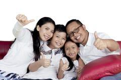 Joyful family with thumbs up Stock Photo