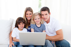 Portrait of a joyful family using a laptop Stock Photography
