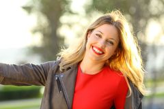 Portrait of a joyful fashion woman in a park. Portrait of a joyful fashion woman smiling outdoors in a park Royalty Free Stock Image