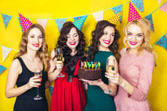 Portrait of joyful friends toasting and looking at camera at birthday party.Smiling girls with glasses of champagne. Portrait of joyful friends toasting and Royalty Free Stock Photo