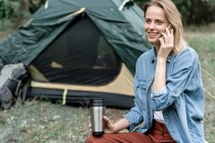 Happy young woman speaking by cellphone in the nature stock photo