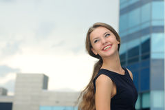 Portrait of a joyful and happy business woman. On the background of office building Stock Image