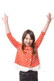 Portrait of a joyful little girl  with arms raised Stock Photos