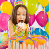 Portrait of joyful little girl with cake at Stock Photo