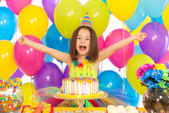 Portrait of joyful little girl with cake at Stock Photography