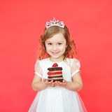 Portrait of joyful little girl with cake celebrating her birthday Stock Photo
