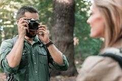 Happy loving couple using camera in the nature stock photo