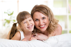 Portrait of a joyful mother and her daughter lying Royalty Free Stock Photography