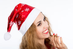 Portrait of joyful pretty woman in red santa claus hat laughing Stock Photography
