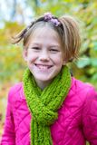 Portrait of a joyful teenage girl, with a funny hairdo. In an autumn forest, on a blurred background Royalty Free Stock Photography