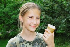 Portrait of a joyful teenage girl with ice cream in her hand Royalty Free Stock Photo