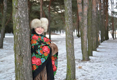 Portrait of the joyful woman of average years in the winter pine wood Royalty Free Stock Images