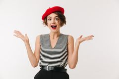 Portrait of a joyful woman dressed in red beret. Screaming and looking at camera isolated over white background Stock Photo