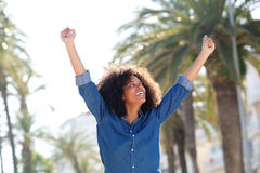 Joyful woman outside with arms outstretched Royalty Free Stock Images