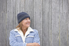 Portrait joyful woman warm clothes timber background Stock Photography