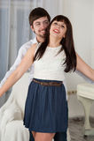 Portrait of a joyful young couple at home Stock Photos