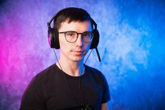 Portrait of a joyful young gamer in headphones. Computer Games Concept stock photo